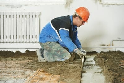 Employee from Gladstone Concreters working on the concrete of a house